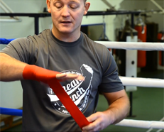 Wrapping Your Hands for Boxing – How to Box (Quick Video)